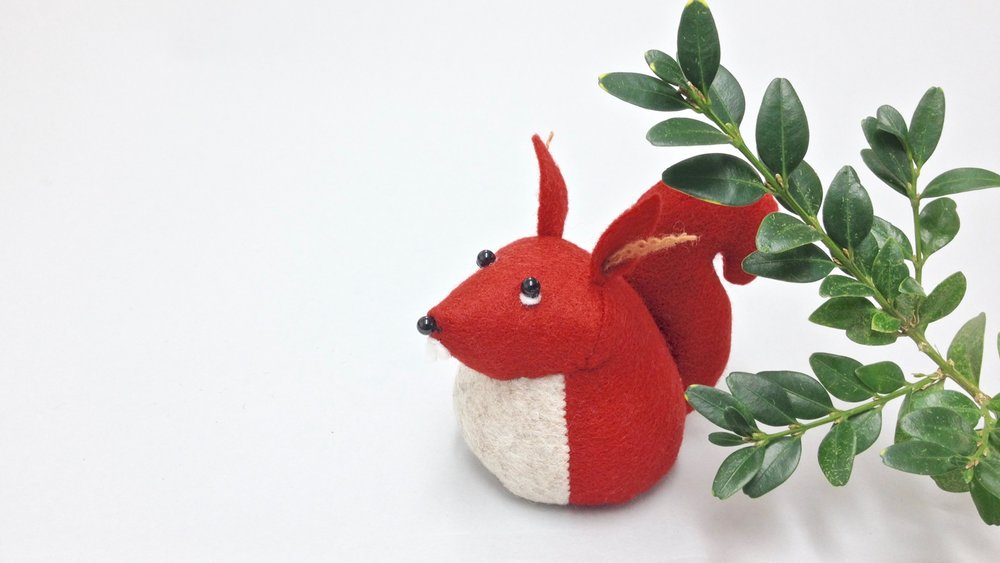 Bilberry Woods storybook character Hemingway the Squirrel handmade from wool felt by Laura Mirjami | Mirjami Design.