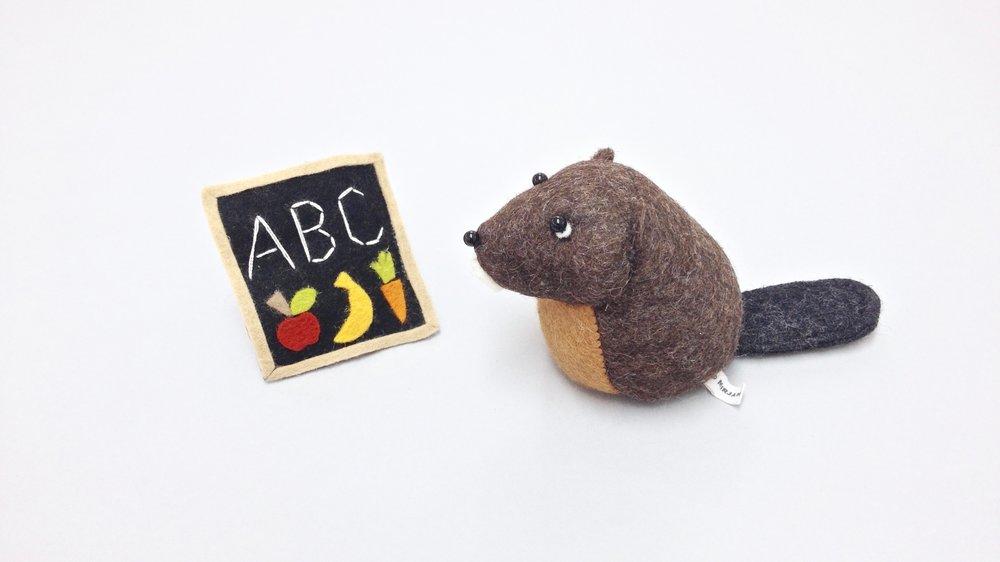 Bilberry Woods character Bella the Beaver who loves learning handmade from wool felt by Laura Mirjami | Mirjami Design.jpg