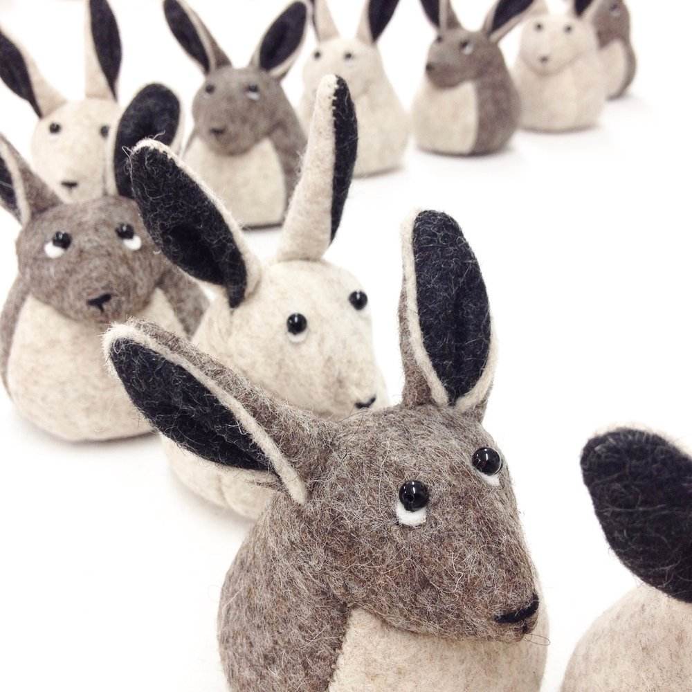 Handmade wool felt hare sculptures by Laura Mirjami