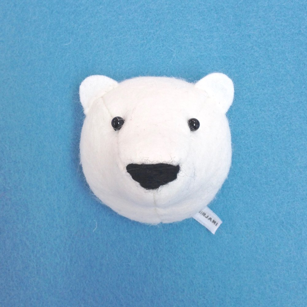 Handmade wool felt polar bear fridge magnet by Laura Mirjami