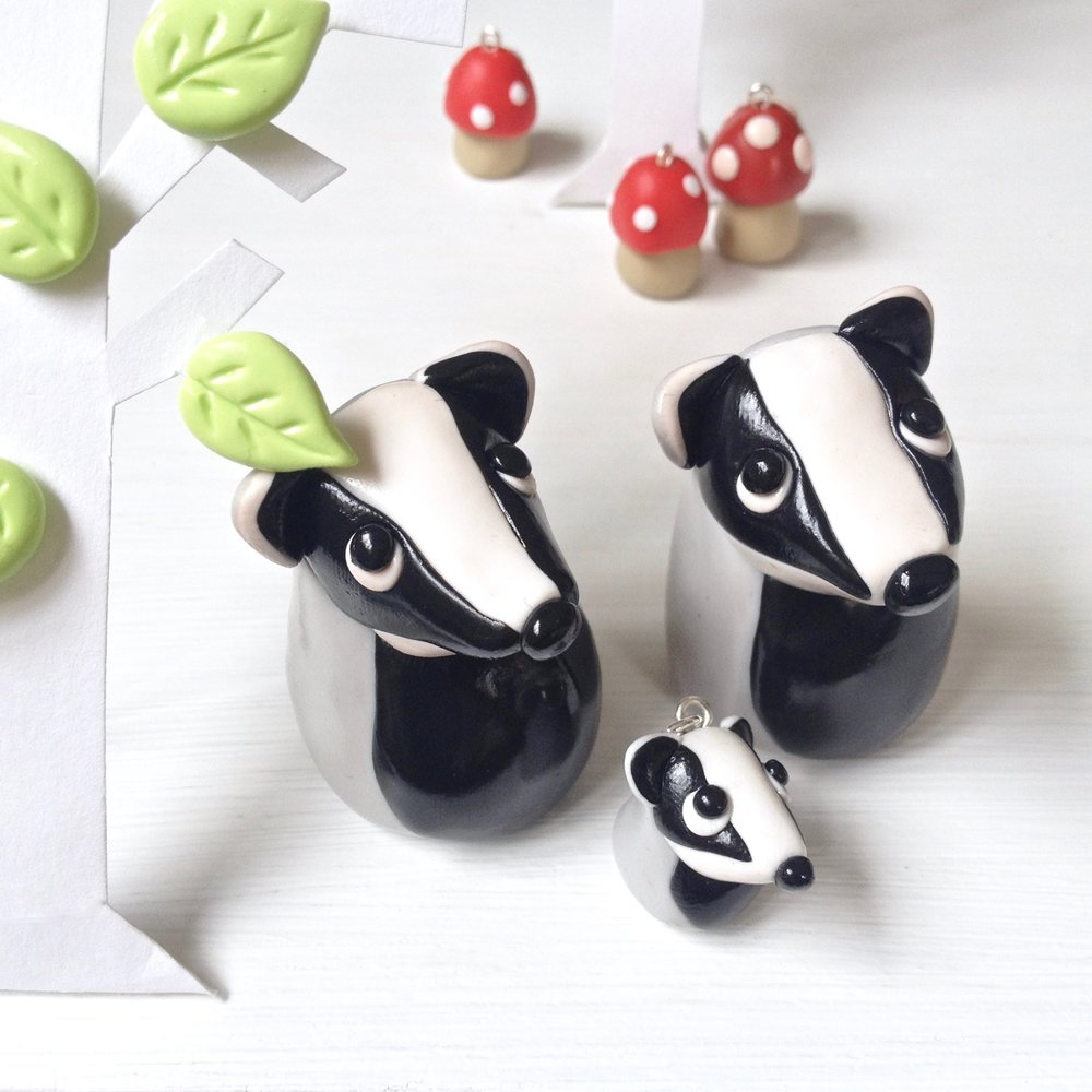 Handmade Fimo polymer clay badger figurines by Laura Mirjami