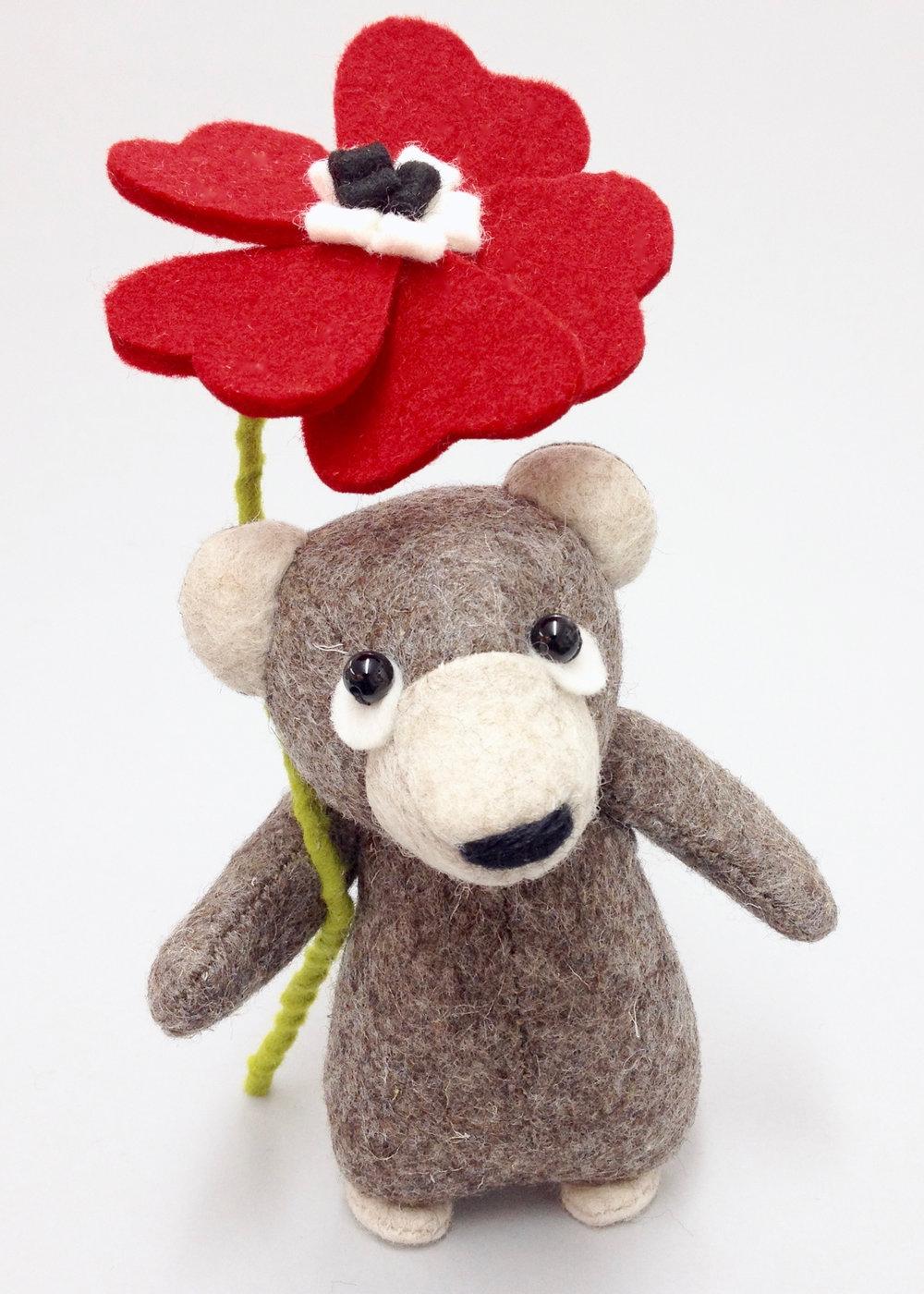 Bilberry Woods brown bear with a felt flower by Laura Mirjami