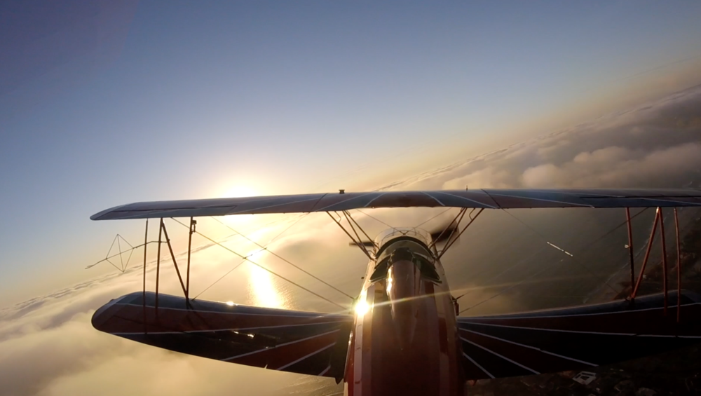 There is something magical about a vintage biplane around sunset.