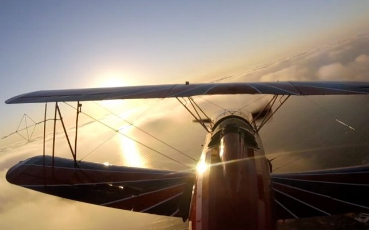 There is something magical about our single person open cockpit biplane --especially around sunset.