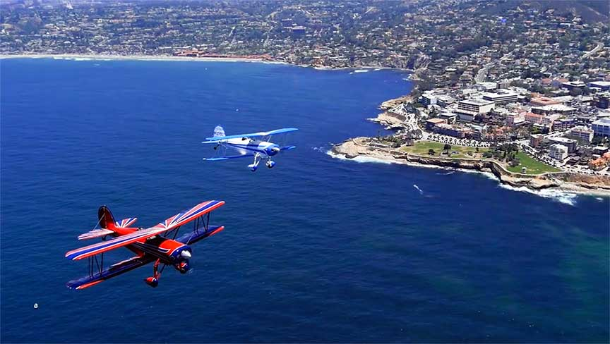 Flying off shore La Jolla is captivating.  These biplanes are getting ready to pass the famous Windansea Beach.