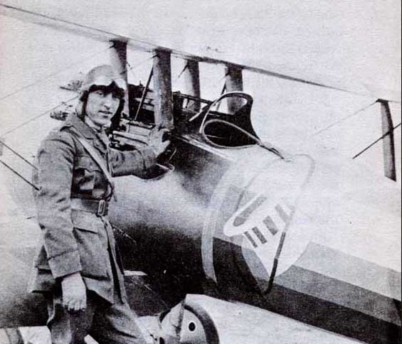 WWI Ace Eddie Rickenbacker getting ready to fly his SPAD biplane fighter.