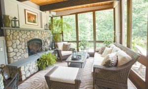 The screened-in porch serves as a warm weather family room and is a favorite gathering spot.