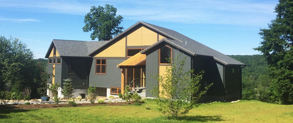 ridgefield-modern-hillside-house-side.jpg