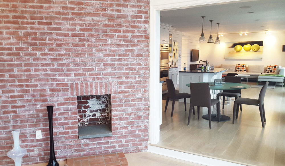Stamford-on-the-water-fireplace-and-kitchen.jpg