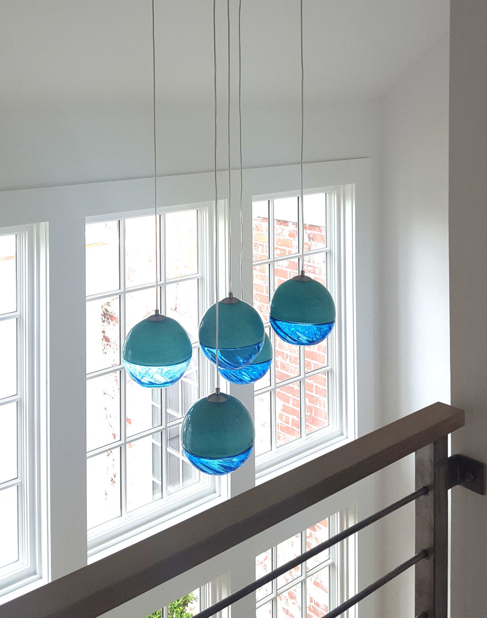 Stamford-on-the-water-blue-pendant-lights.jpg