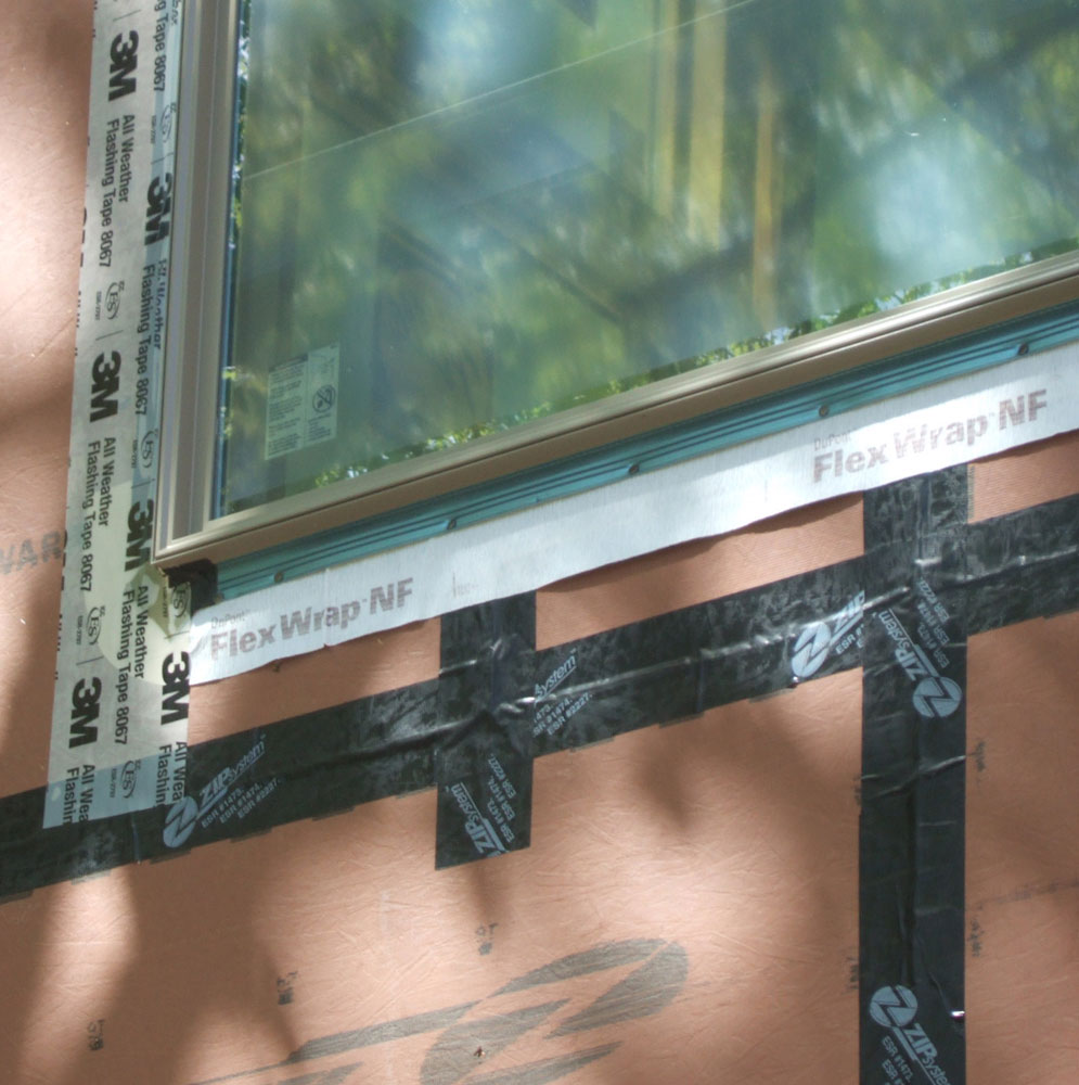 Air-sealing tape seals all gaps in sheathing and around windows and doors