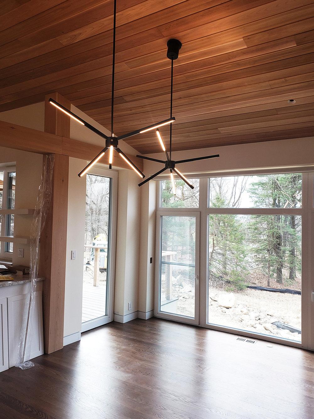 LR corner windows and kitchen 4.11.19.jpg