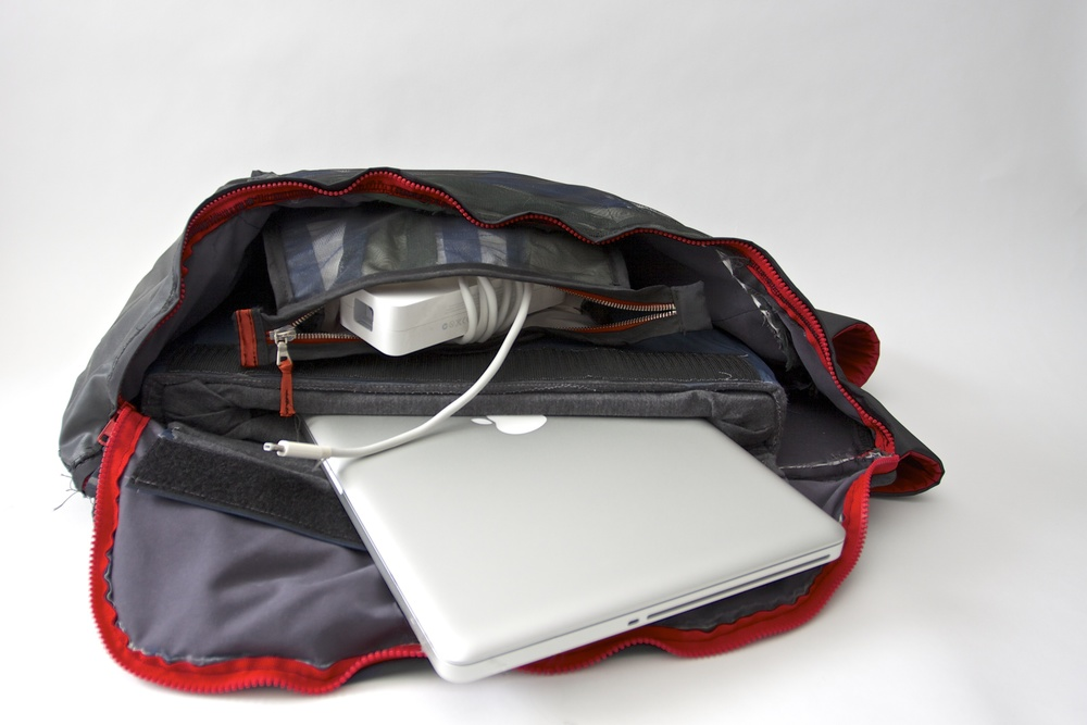 Bag open with laptop and accessories