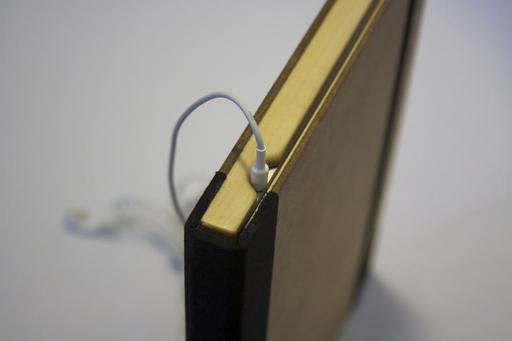 Old Book Case - Headphone Cable in