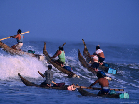 Fishermen Paddle Their Cabillitos De Totora Reed Boats Out Through Waves, Pimentel, Peru by Paul Kennedy