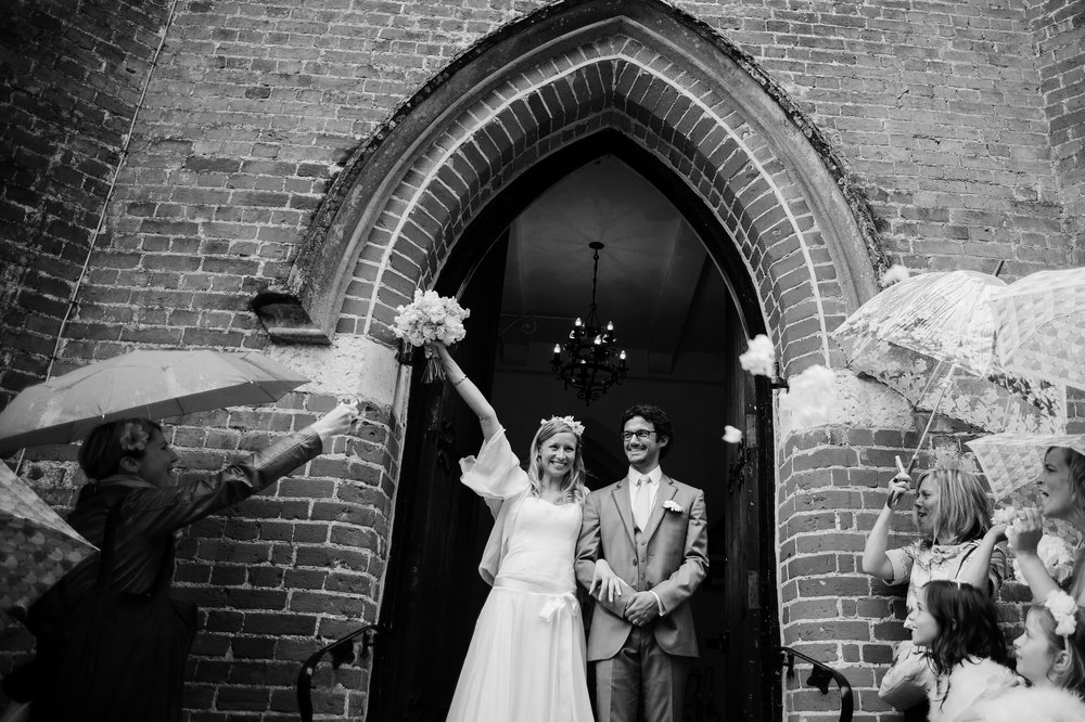 """Miranda & Vincent - """"Antony turned a very wet day into beautiful luminous photos. He was a pleasure to work with, got on with his job without being intrusive or pushy. We love the results and would not hesitate to recommend him to other couples looking for laid back, reportage style photos."""""""