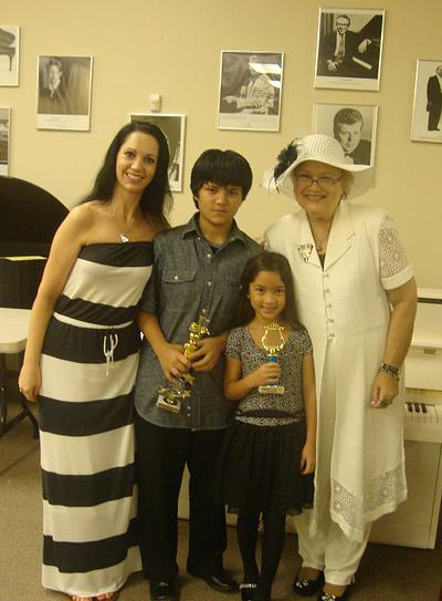 Marilyn and her two daughters, Lauren and Lily, after a July 2012 piano recital with their teacher, Eileen Mattioli, of St. Petersburg, Florida. Mrs. Mattioli was Marilyn's first teacher at the age of 5.