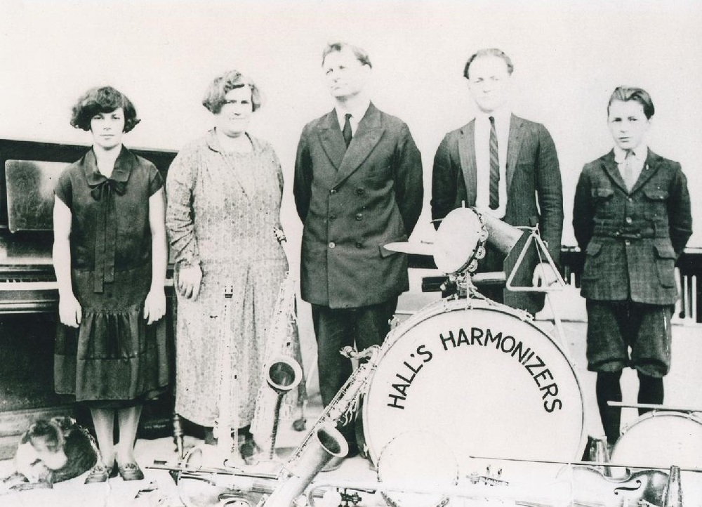 """Hall's Harmonizers"" ca. 1925. Cory's great grandparents with their three children posing for their family band portrait. From left to right: Audrey, Lillian (mother), Andrew (father), Lewis, Kenny"