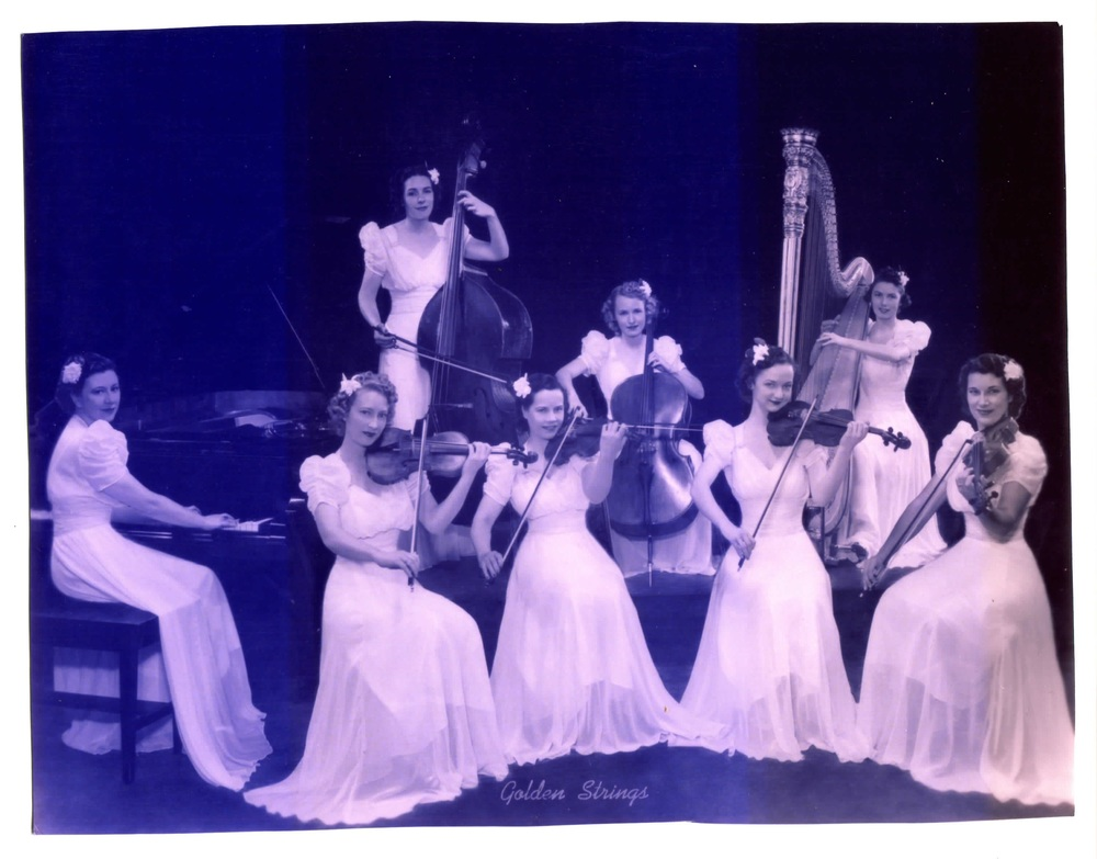 Cory's great aunt, Audrey, in a professional photo from ca. 1936 (front, middle). A professional violinist who also played other instruments, Audrey was the lead violinist in this all-women strings group.