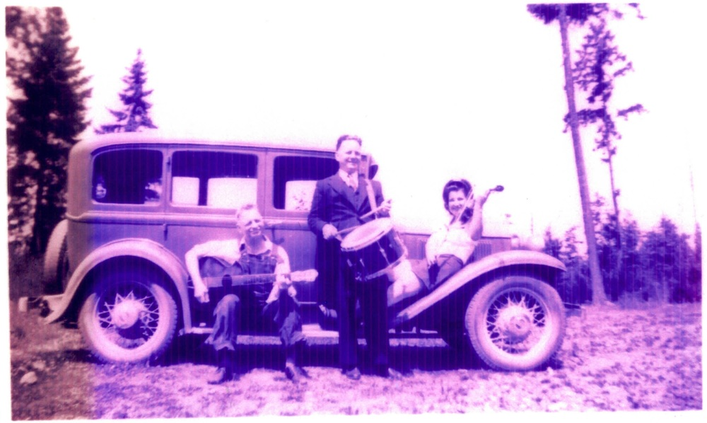 From left to right: Cory's great grandfather Andrew (guitar), grandfather Lewis (drum), great aunt Audrey (violin) posing on their car, ca. 1935.