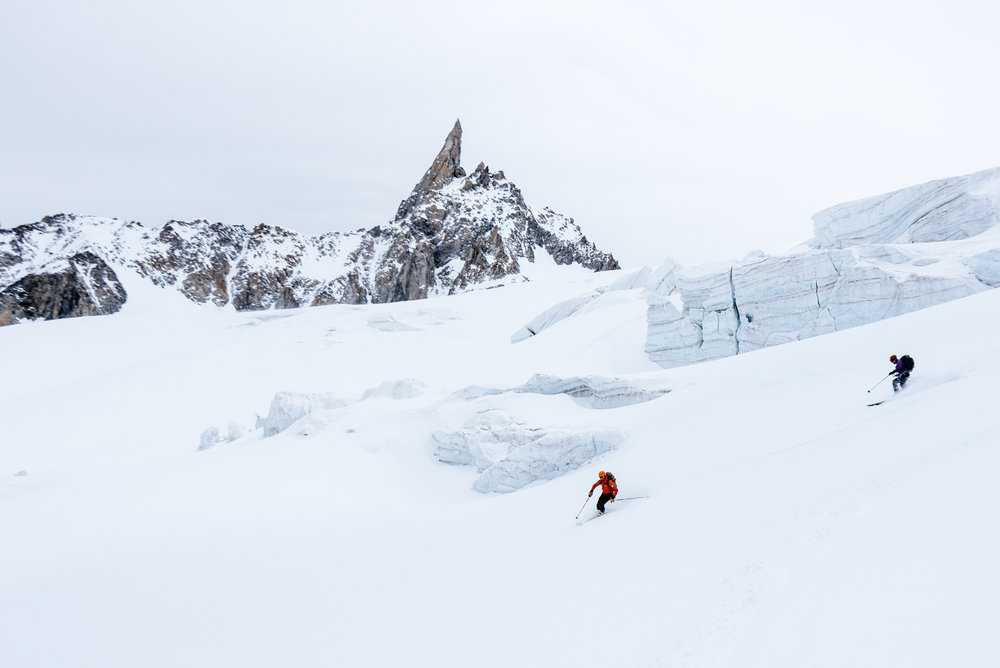 Jeff Banks and a client descending down the Vallee Blanche, Chamonix, France, after a tour up the glacier.