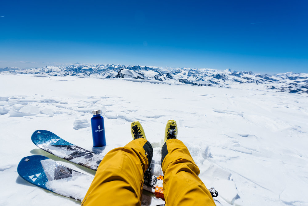 A backcountry touring kit consists of skis, touring bindings, touring boots, and skins.