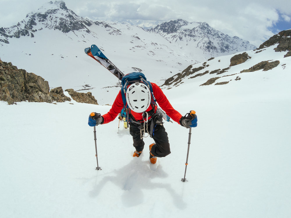 Bootpacking up a colouir to ski some steeps on Austria's classic Silvretta Tour with Jeff Banks.