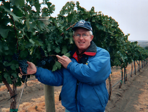 Doug Holding his first crop of Syrah wine grapes