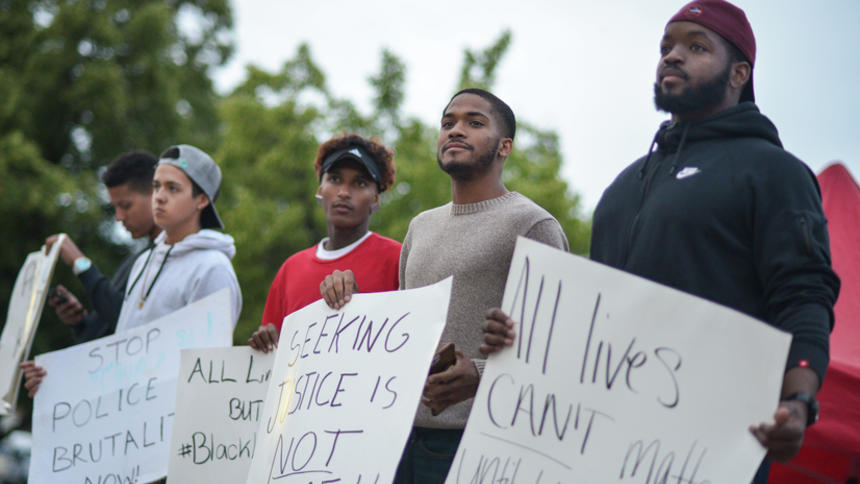 Trevon Mooney, from right, Derrick Williams, Kilo Owen, Mason Colling and Iziah Anderson hold signs during a Black Lives Matter protest in downtown Fargo on Thursday, July 14, 2016. Rick Abbott / The Forum