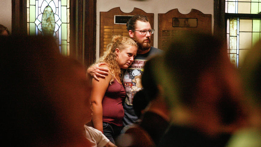 ayla Pridmore, left, and Christian Schultz embrace Sunday, June 12, 2016, during a vigil at First Congregational United Church of Christ to mourn the victims of the Orlando nightclub shooting. Rick Abbott / The Forum