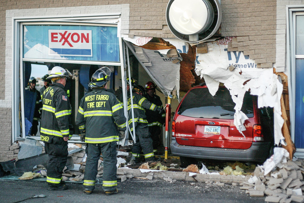 Minivan crashes through West Fargo car wash
