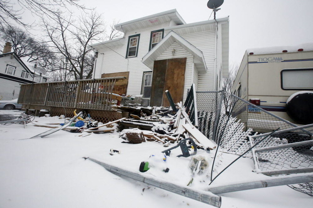 Damage seen Sunday, Feb. 14, 2016, after a standoff and shootout on Feb. 11 at 308 9th Ave. N. in Fargo. Rick Abbott / The Forum
