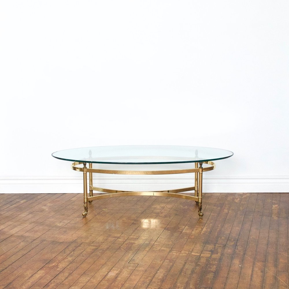 "Brass & Glass Oval Table    $48    4'2"" w, 1'4""h"