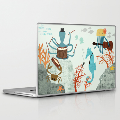 various laptop and iPad skins