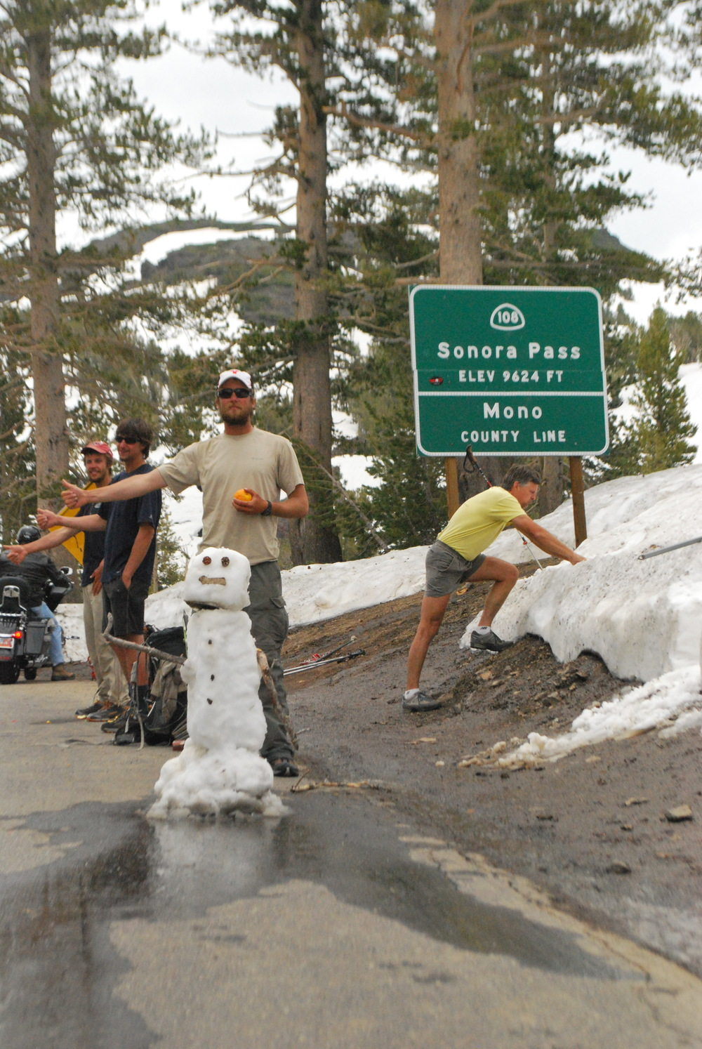 Sonora Pass with hitchhiking snowman and lunging day-hiker.