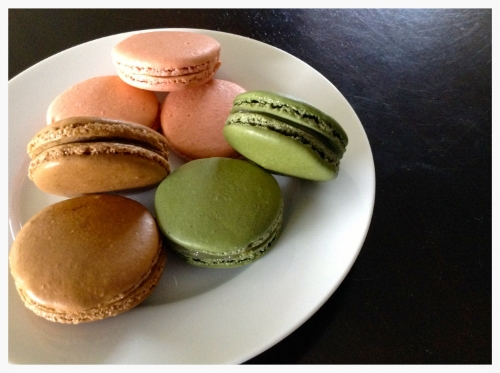 Brown Macarons - espresso flavoured shells with dulce de leche filling Green Macarons - plain shells with lime curd filling Pink Macarons - cinnamon shells with mango filling