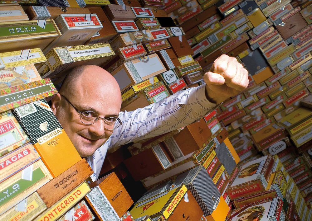 Portrait of Jean-Charles Rios of Gestocigars in Geneva breaking down the walls of high-priced cigars. This image was a huge success with clients and press.