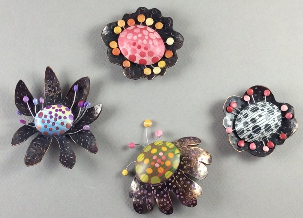 "Petal Bop Pins 2018  polymer clay millefiori marquetry, patinated bronze and copper, sterling silver, stainless steel wire, acrylic paint  2"" x 2"" x .375"" D"