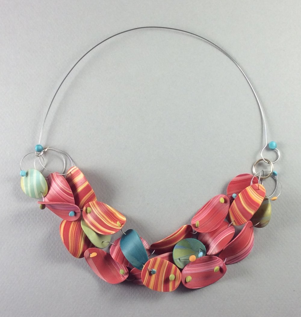 "Floating Necklace  2018  Polymer veneer, stainless steel wire, patinated sterling silver  7"" w x 3"" H"