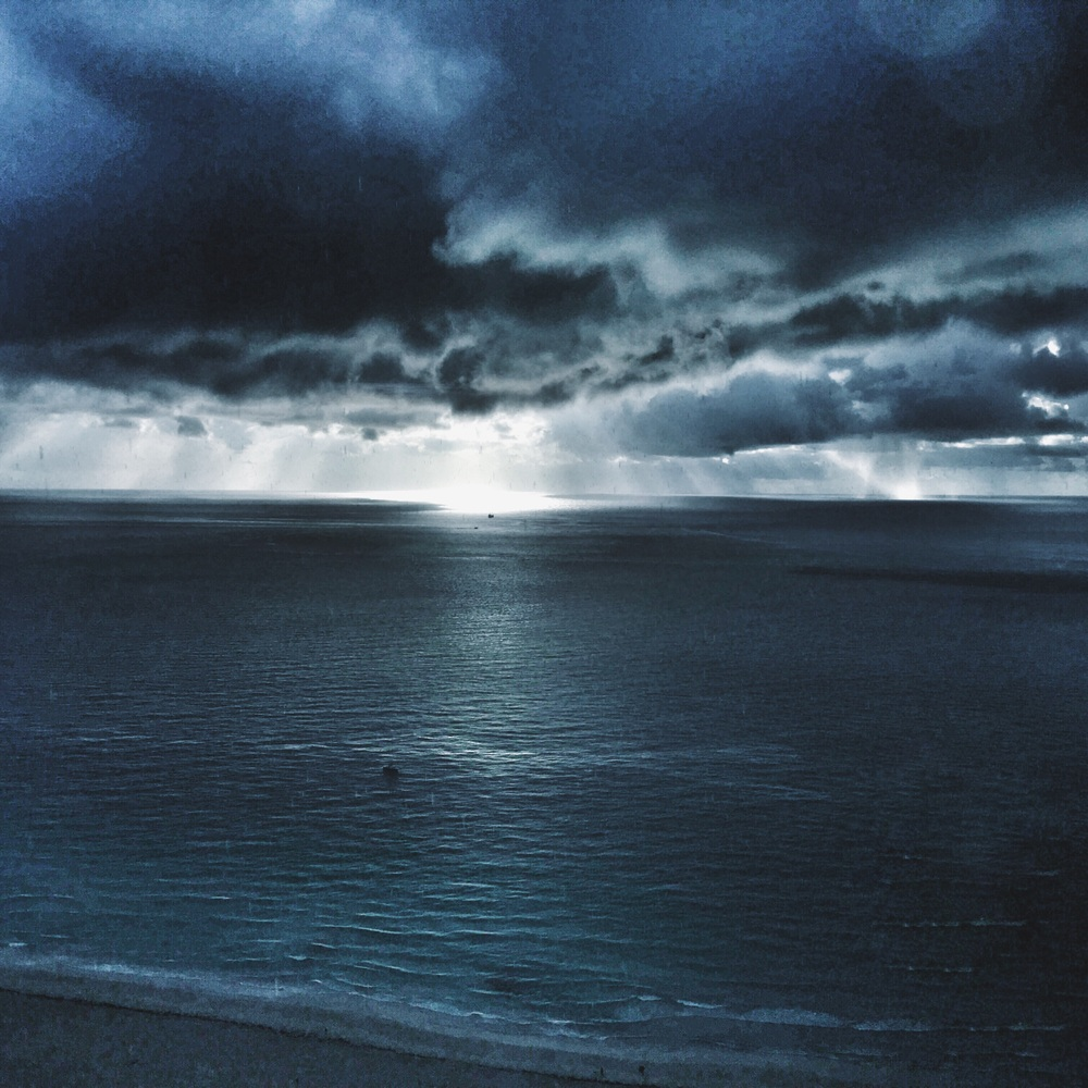 It was raining where we were and there was sunshine on the ocean. So beautiful. The sky was so majestic.