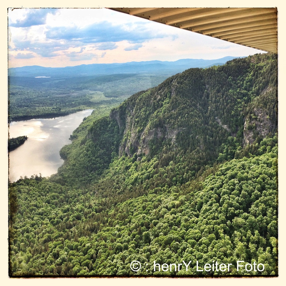 Seaplane view of cliffs in Rangeley Lakes Region Maine.
