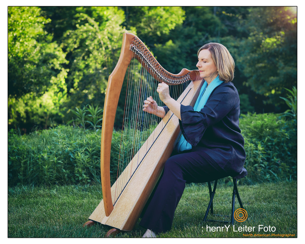 Kate playing a beautiful tune on her Harp for me near her organic gardens.
