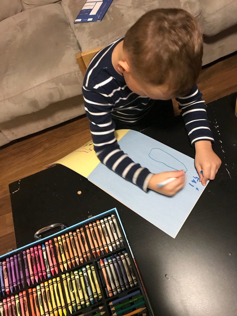 Our 5 year-old drawing pictures to his birth grandmother and half brother for the first time!  —Kathryn
