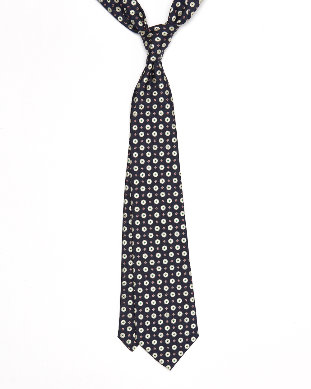 The Oscar Tie has white dots, with green and pink diamond patterns on a navy background, which will compliment the classic navy suit for an example. Click on photo for more information on this tie.