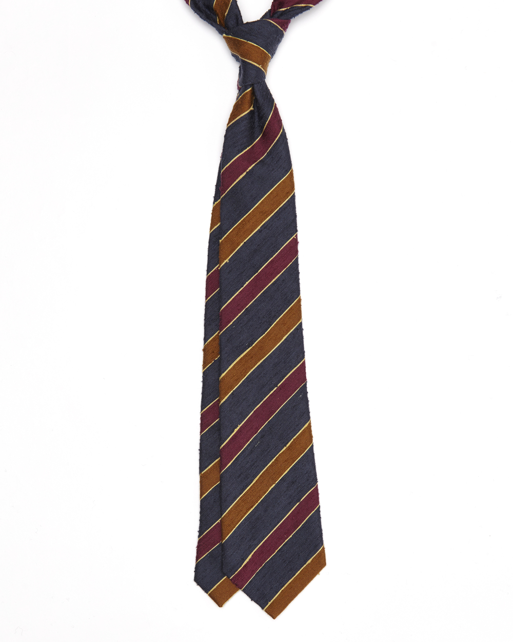The Leonard Tie has a lovely slub texture accredited to the burutti silk quality, which would look great on your 'casual' looks  like a chambray shirt and cardigan for an example. The blue, burgundy and burnt orange stripes will certainly lift the overall appearance and even compliment other colours he (or she) may be wearing such as a burgundy fedora. Click on photo for more information on this tie.