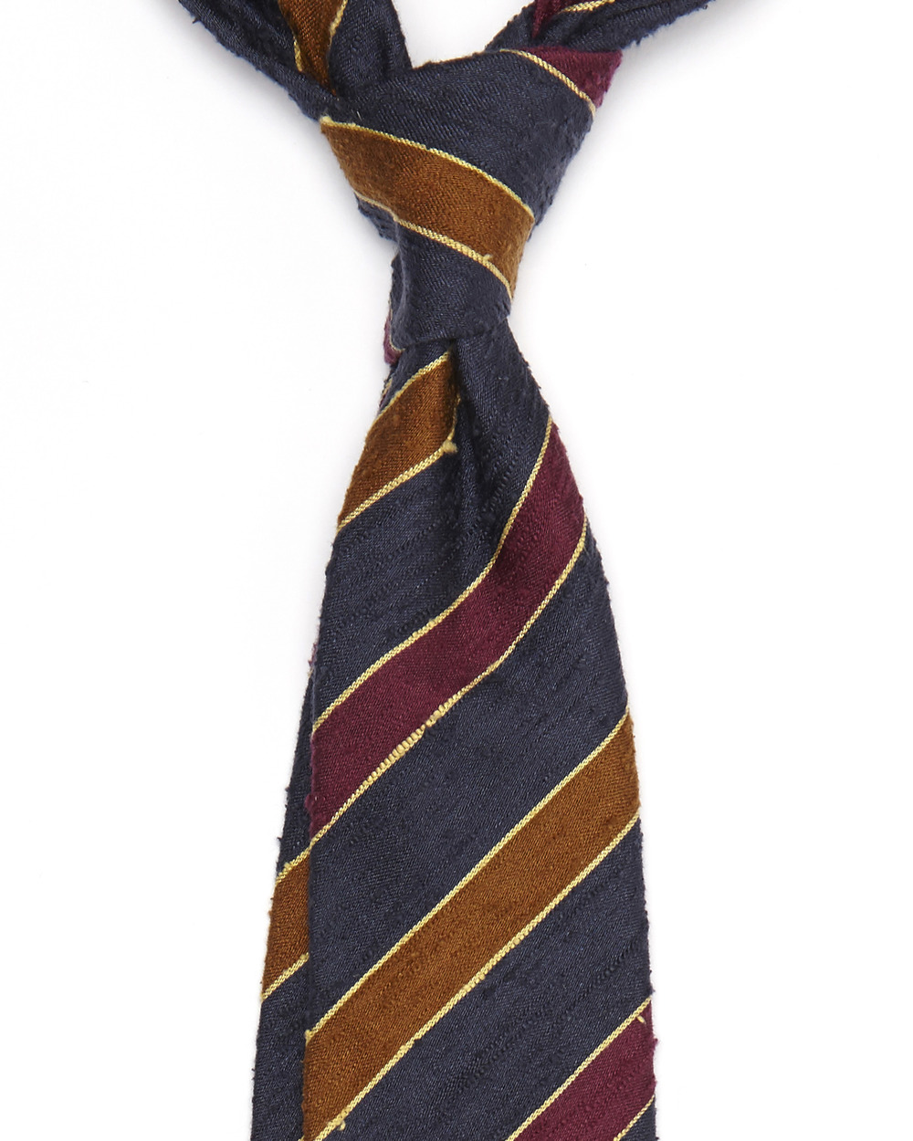 Leonard tie: Made from Burutti silk, which is apart of the raw silk family and has a soft slub texture.