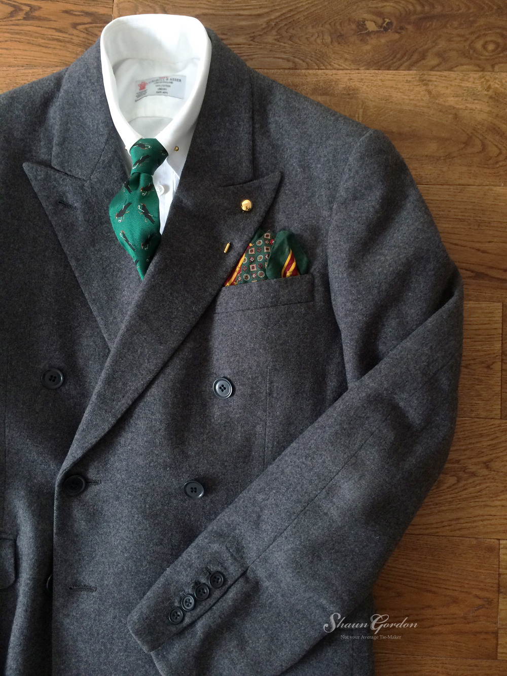 Grey Inspiration: One thing I like about grey is that it allows you to experiment and use bold colours like red, cobalt blue and even emerald green. In this case the Ernest tie gives a bold impression.