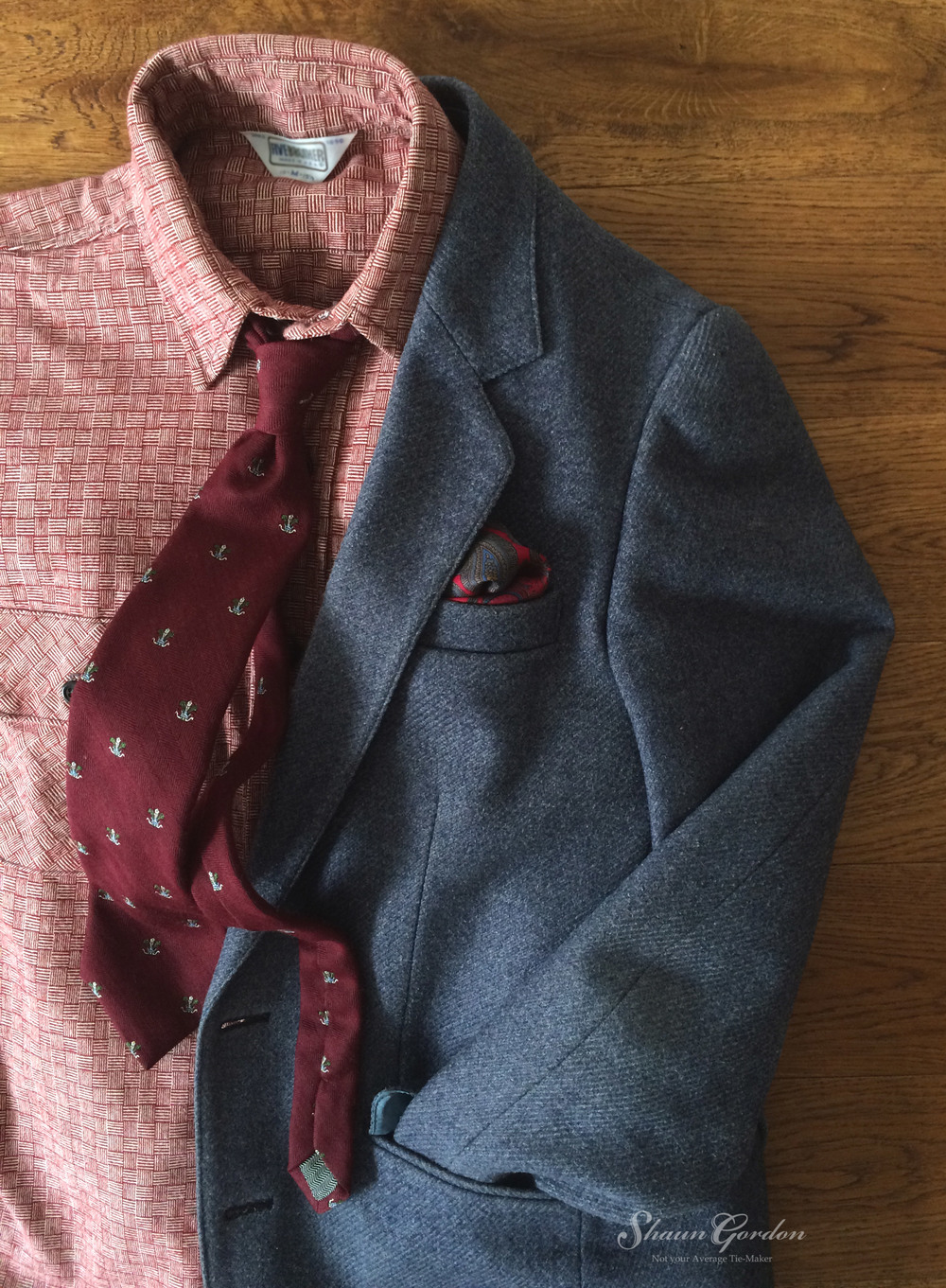 Texture &Colour: How about taking a casual approach, mixing burgundy with blue, although this style is not for the timid hearted,it will certainly leave a lasting impression with your date. Take note of how the different textures and the tonal colour levels of the shirt and Harold tie works together nicely.