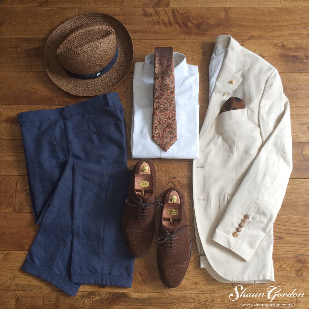 Montgomery Style: Plays around with the Browns to Copper tones. The Off-White jacket and Blue linen trousers acts as a perfect canvas for these. If you do not like wearing shorts then linen trousers are a must!