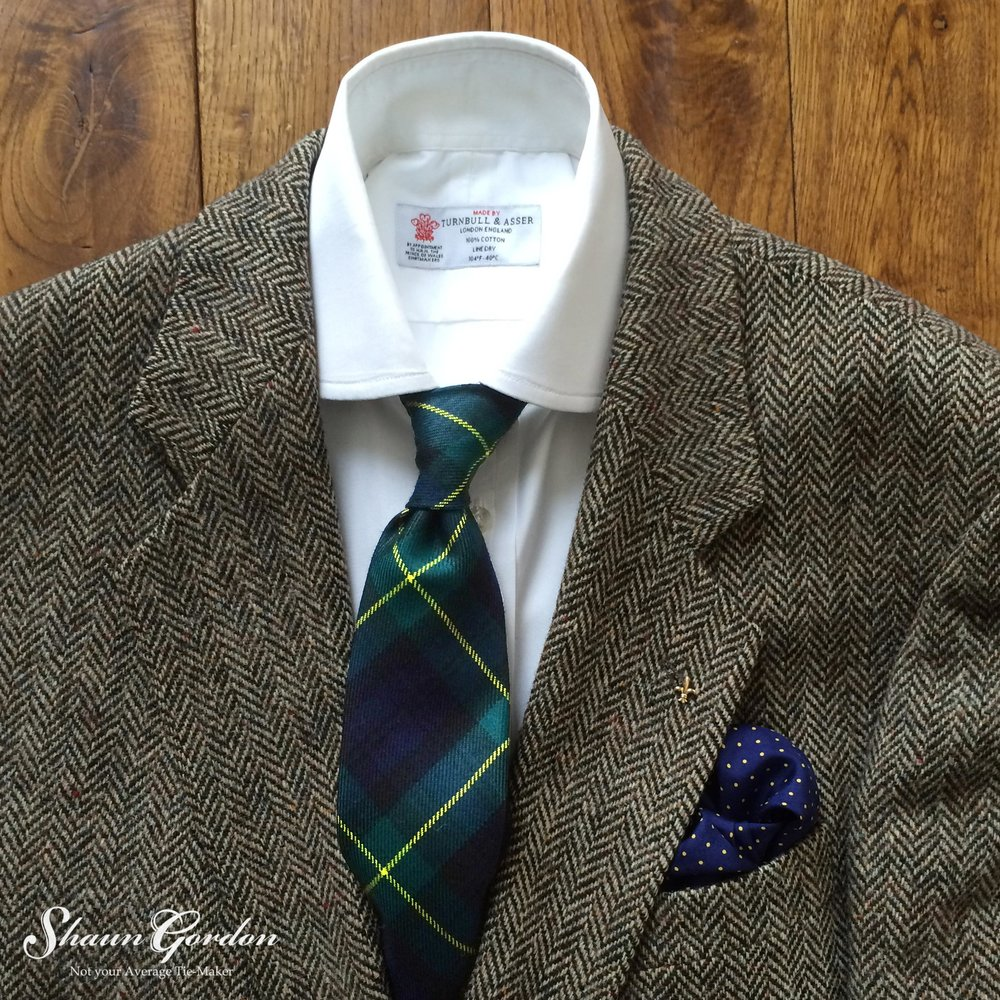 Welcome to part two of the perfect time for a fresh and your tweed look (final)! If you didn't catch part one then click here and catch up with all the things that you missed!    Sometimes we want to wear a tweed jacket as our base layer and this is where we can use our ties to make all the difference such as the Gordon tartan tie, which has a lovely bold yellow window pane pattern and stands out against the tweed brown hues. This creates a tasteful distinguishing appearance without standing out too much.